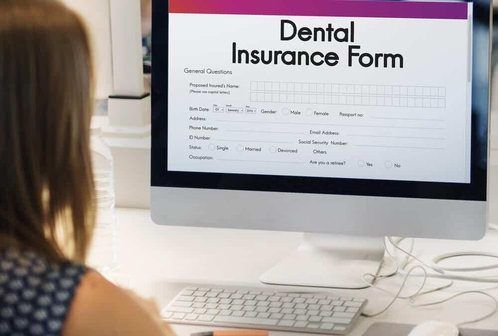 woman looking at dental insurance