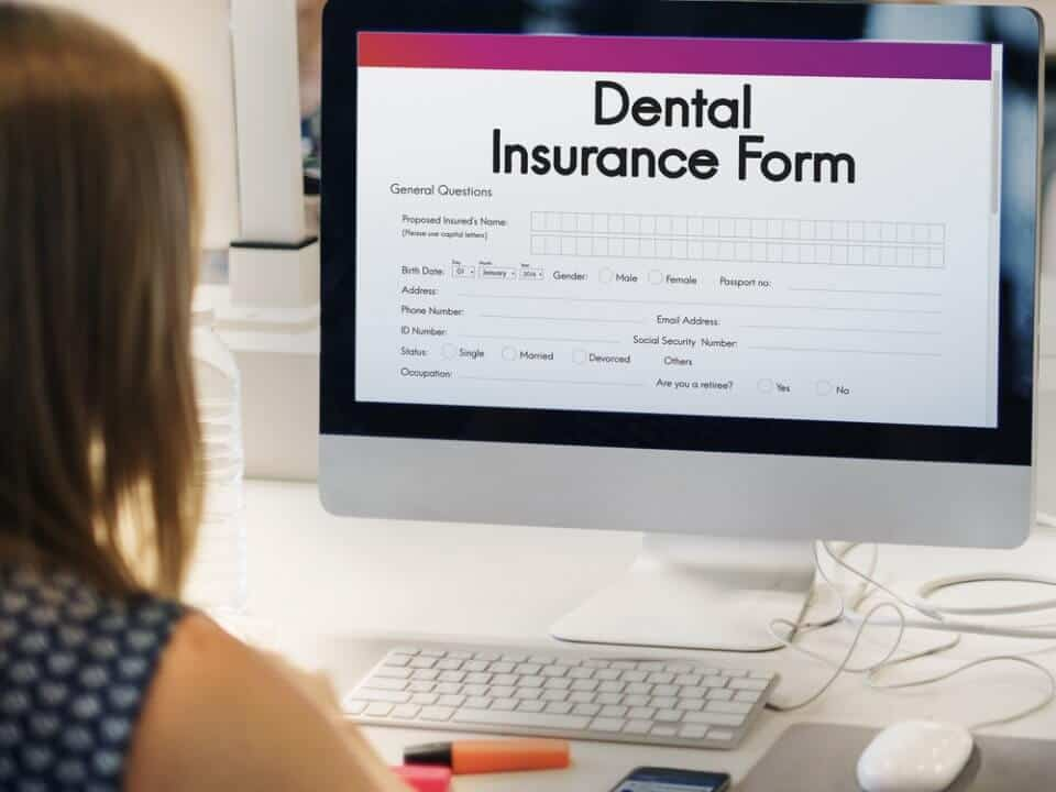 woman looking at dental insurance