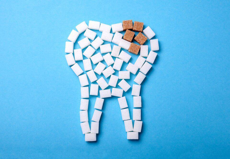 Sugar cubes in the shape of a tooth that has a cavity