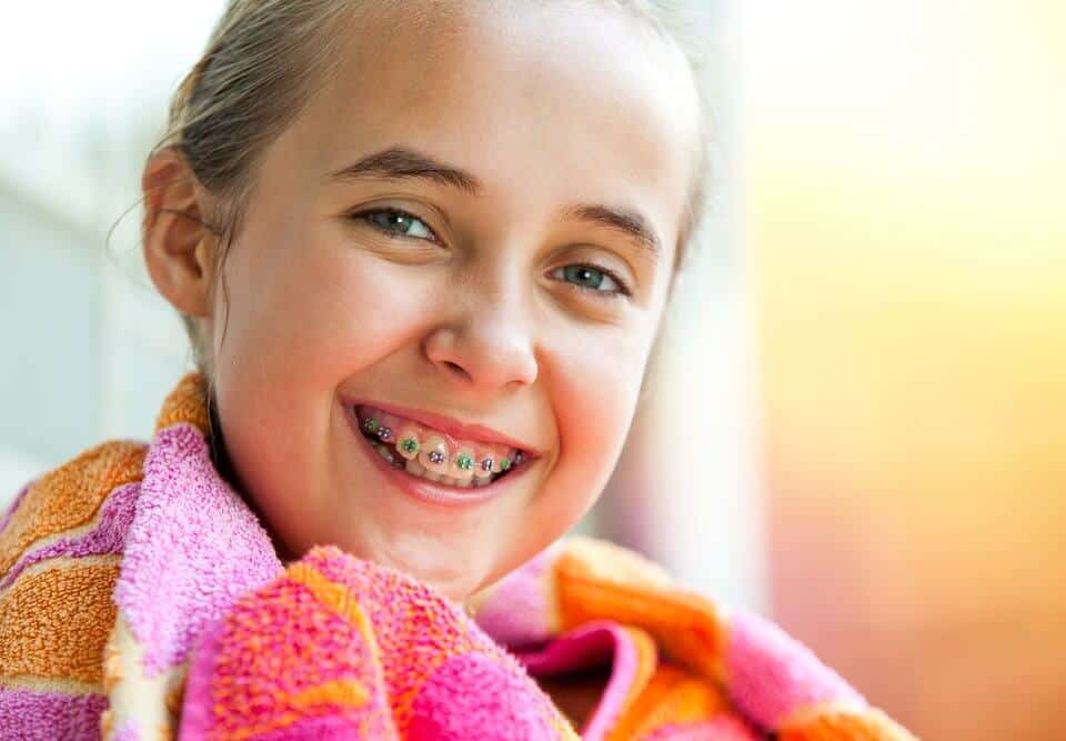 A child with braces smiling
