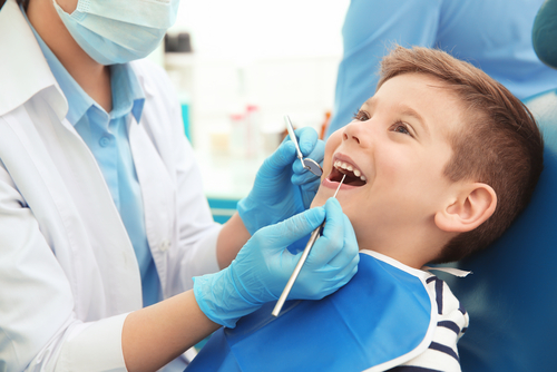 a child in a dentist's chair
