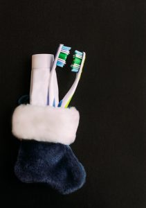 a toothbrush in a holiday stocking